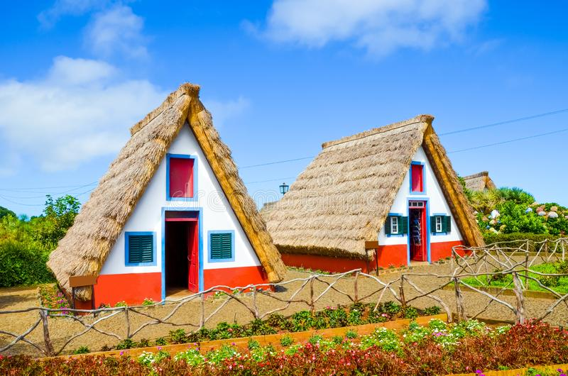 Traditional colorful houses in Santana, Madeira, Portugal. Small, wooden, triangular houses with thatched roof represent a part of stock photo