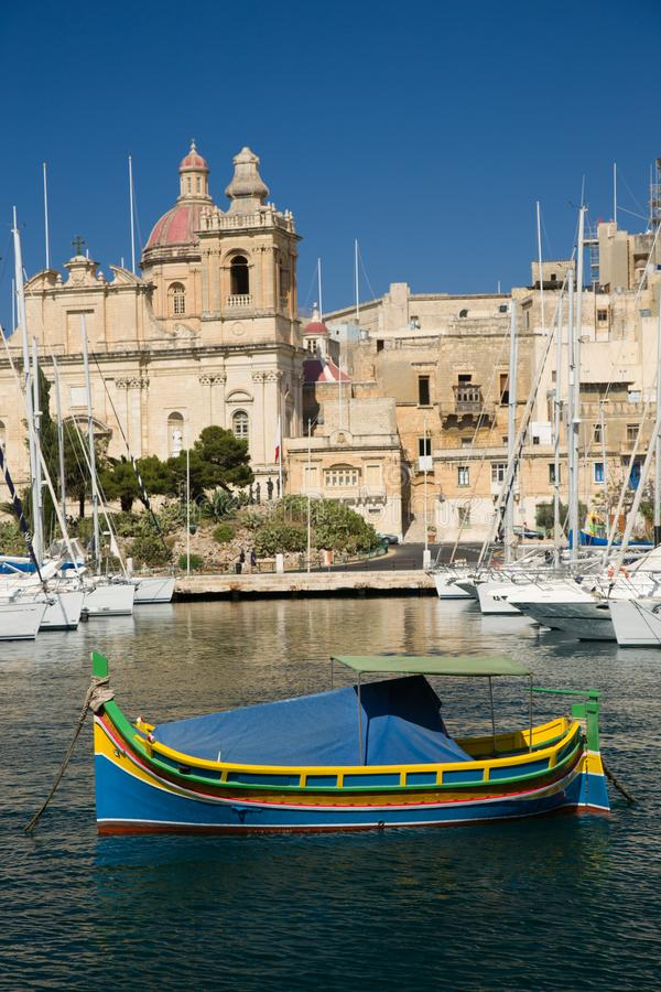 Traditional colorful maltese fishing boat in harbor of Malta royalty free stock photos