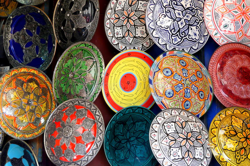 Traditional colorful Moroccan faience pottery dishes in a typical ancient shop in the Medina's souk of Marrakech, Morocco.  royalty free stock photography
