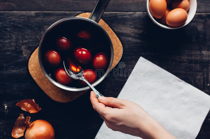 Traditional coloring Easter eggs with onion stock image