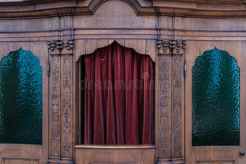 Traditional confessional to take away his sins royalty free stock photo