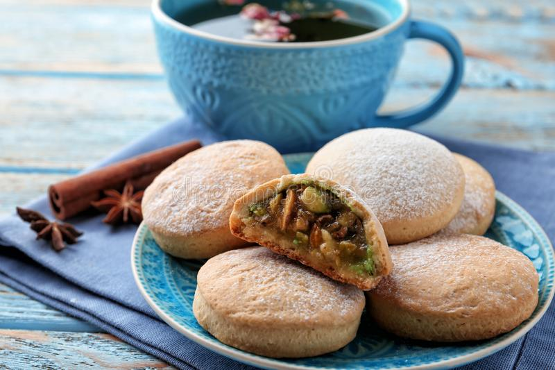 Traditional cookies for Islamic holidays and tea on table. Eid Mubarak royalty free stock image