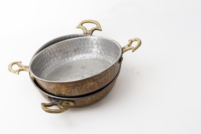Copper pans. A pair of traditional turkish copper pans on neutral background royalty free stock image