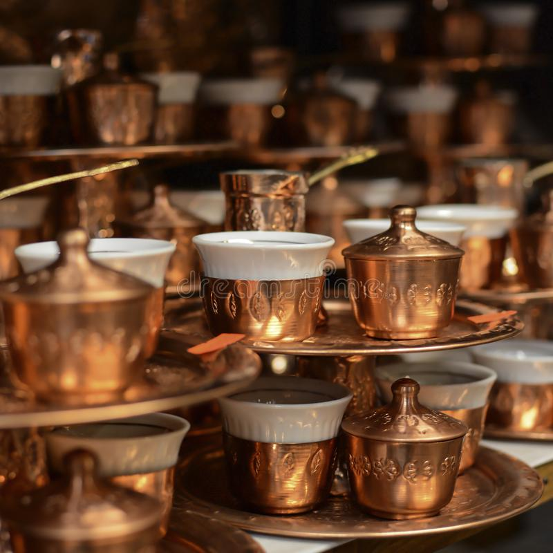 Traditional copper and silver-plated coffee pot souvenirs from Bosnia. Turkish coffee pots. Traditional copper and silver-plated coffee pot souvenirs from stock images