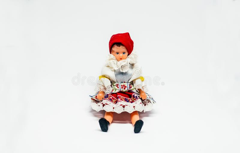 Traditional Costume Doll Sitting on white background royalty free stock photos