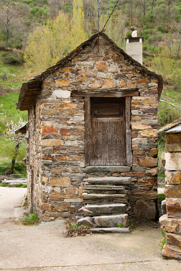 Traditional Cottage with Stone Staircase. Small house old traditional stone built. With the steps of the staircase leading to the main gate built with stone stock photos
