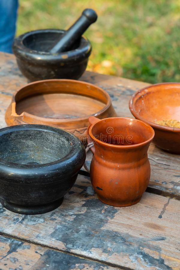 Traditional country dishes crockery natural jug plate wooden table background rustic stock photos