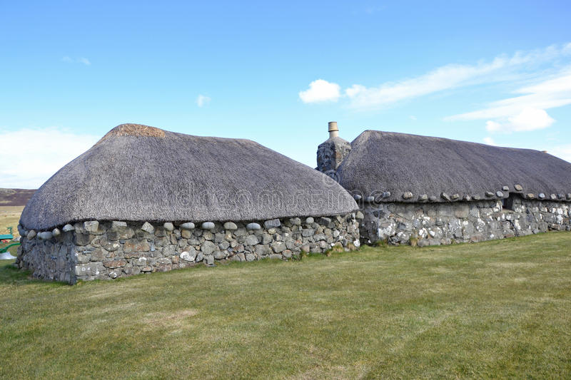 Traditional Crofters Cottages. Traditional Scottish crofters cottages with thatch stock photos