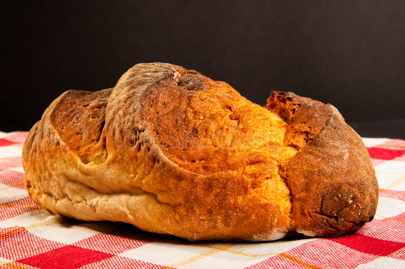 Traditional crusty bread on tablecloth stock photos