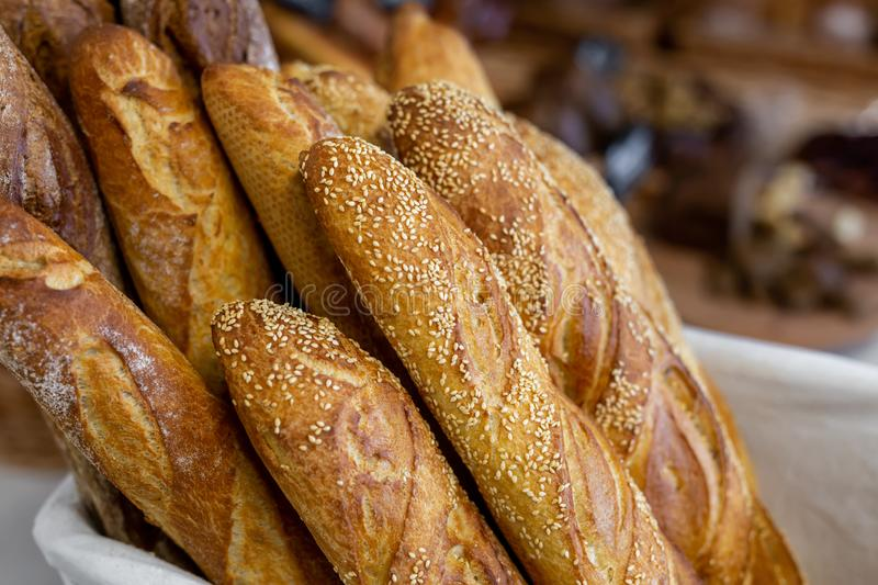 Traditional crusty French bread baguette in basket at bakery. Fresh organic pastry at local market. France cuisine background stock photos