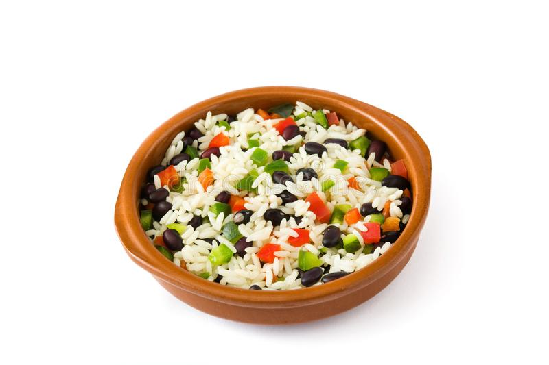 Traditional cuban rice, black beans and peppers isolated. Moros y cristianos. Traditional cuban rice, black beans and peppers isolated on white background royalty free stock photos