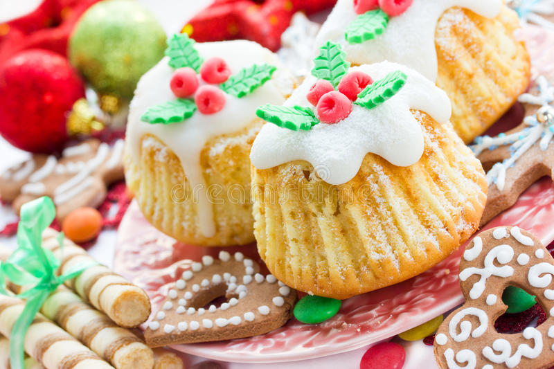 Traditional cuisine. Christmas treats, cupcakes, cookies on a fe stock images