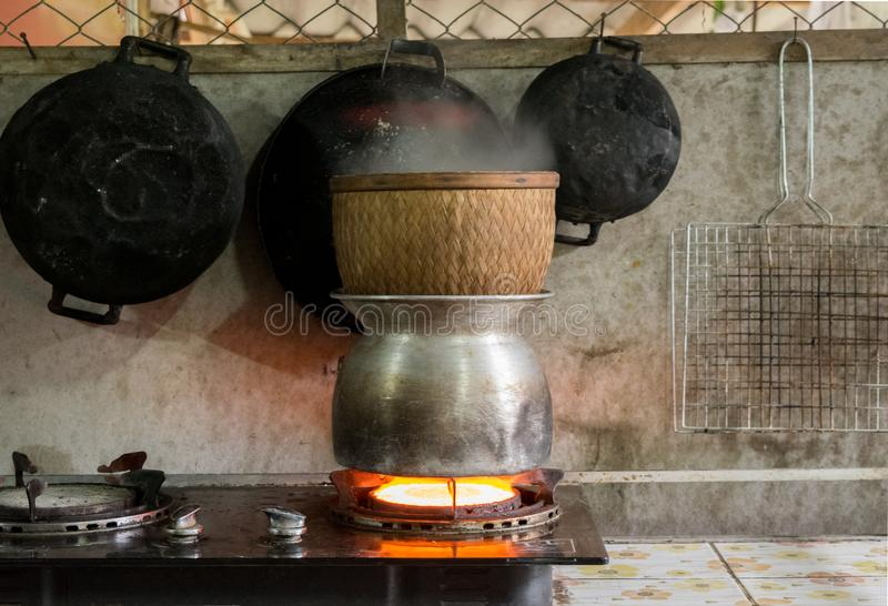Traditional culture cooking sticky rice in Thailand stock photography