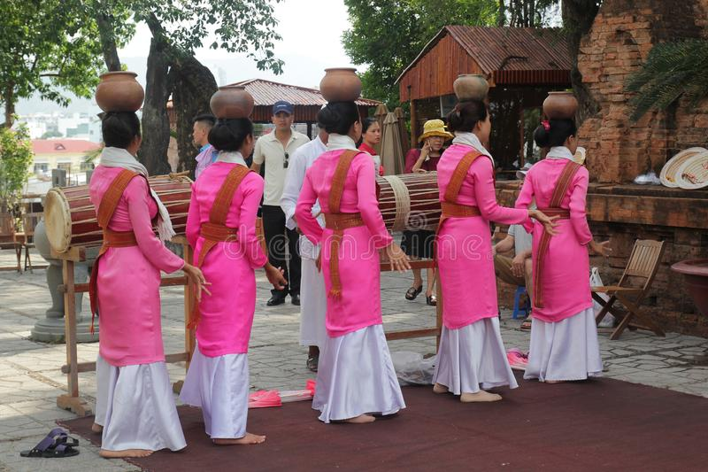 Thap Ba Ponagar, Nha Trang, Viet Nam - May 22,2018: Women in pink long dress is dancing Champa dance of Champa people at Thap Ba p. This is a traditional dance stock images