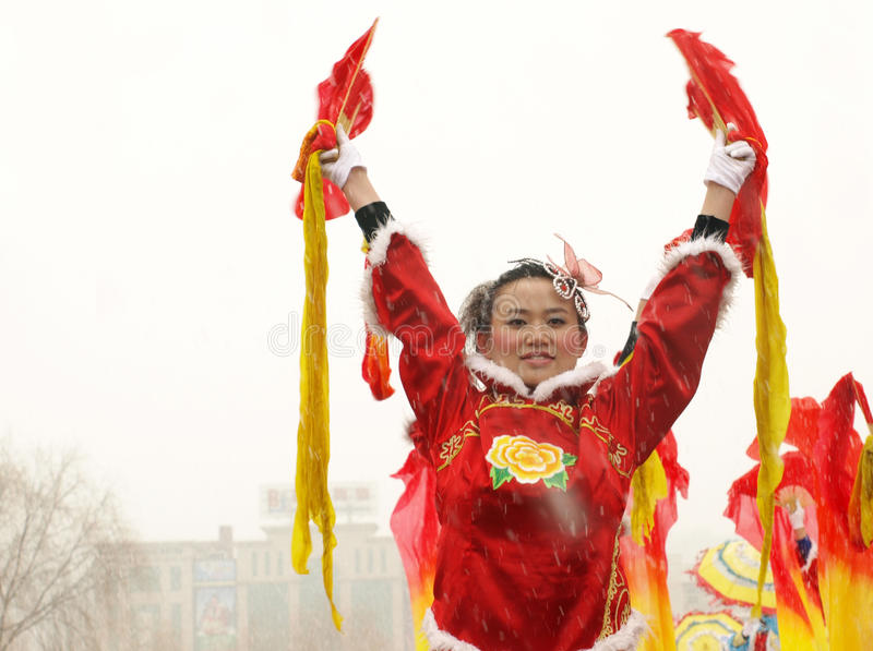 Traditional dance Yangge in the snow stock photo