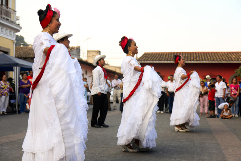 Traditional dancers in Coatepec. To perform in Europe, a group of local dancers, in Coatepec, Mexico, goes to the streets to collect money to pay for trip stock photos