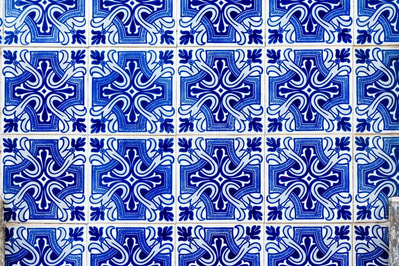 Traditional decoration of the facade of the house in Porto. Typical Portuguese and Spanish ceramic tiles azulejos stock illustration