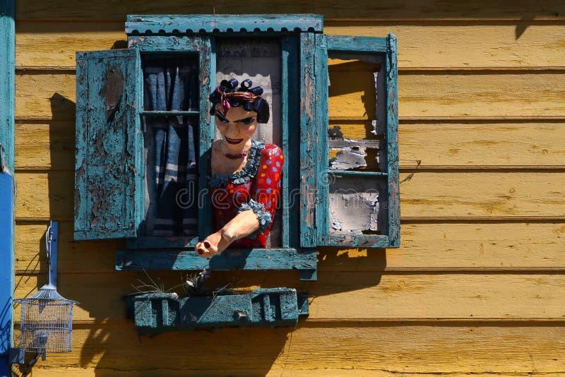 Traditional decoration in La Boca. Woman at the window in La Boca touristic street royalty free stock photo