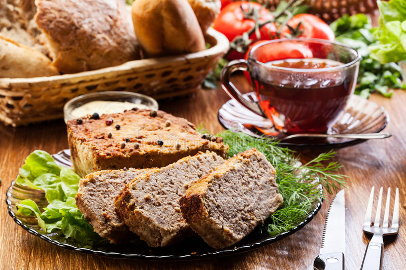 Traditional delicious meat pate with vegetables royalty free stock photos