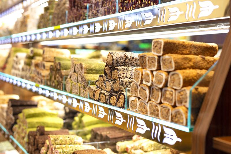 Traditional delicious turkish desserts in the shop window showcase. Different kinds of turkish delights. Popular. Souvenirs and snacks from Turkey stock photo