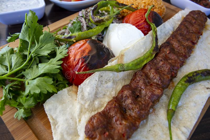 Traditional delicious Turkish foods; Adana kebab. Food concept photo.  stock image