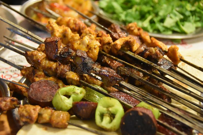 Traditional delicious Turkish foods; skewers cop sis royalty free stock images