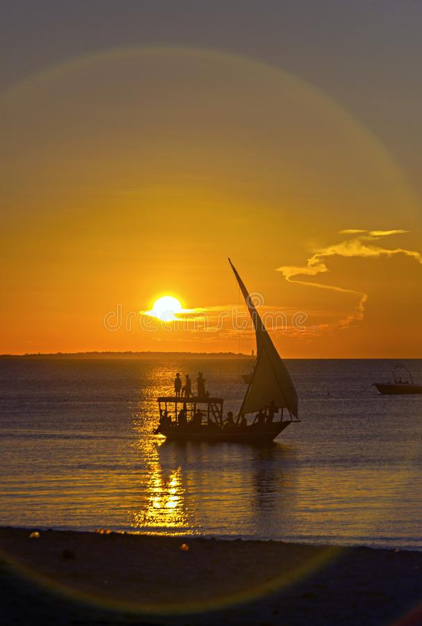 A traditional dhow in Zanzibar, Tanzania, Africa. Sunset dusk sc. Ene in and beach at the Indian Ocean stock photography