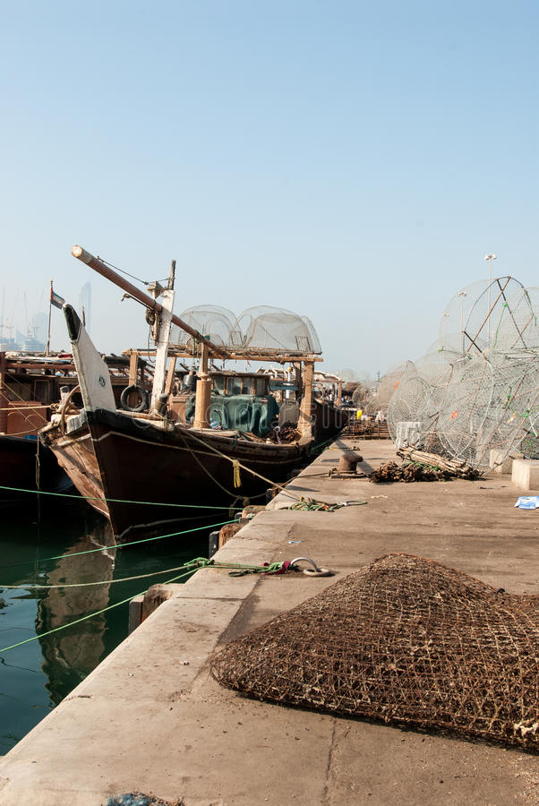 Traditional Dhows in Abu Dhabi. Working dhows in the harbour at Abu Dhabi, UAE royalty free stock photo