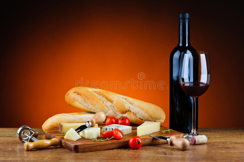 Traditional dinner with cheese and wine stock image