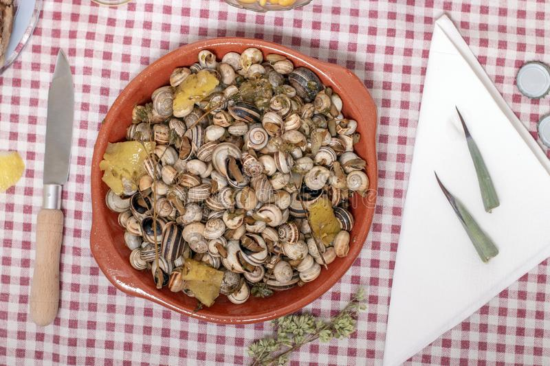 Traditional dish of cooked snails stock images