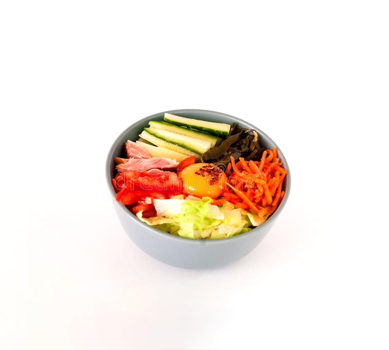 Traditional dish of Korean cuisine. Bibimbap with beef, vegetables and egg on white isolated background. royalty free stock photos