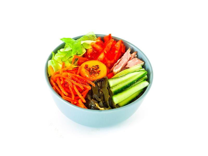 Traditional dish of Korean cuisine. Bibimbap with beef, vegetables and egg on white isolated background. stock photography