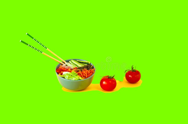 Traditional dish of Korean cuisine. Bibimbap with beef, vegetables and egg on UFO Green background. stock photos