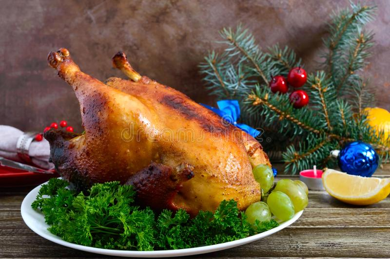 Traditional dish turkey on the holiday table. Festive dinner for Thanksgiving or Christmas royalty free stock photo