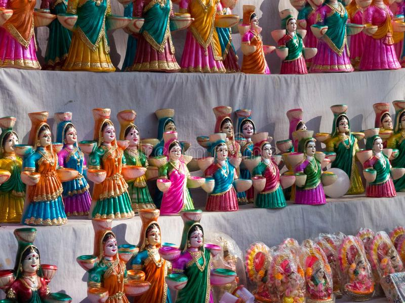 Indian market, Colorful clay dolls lined up for sale-India stock image