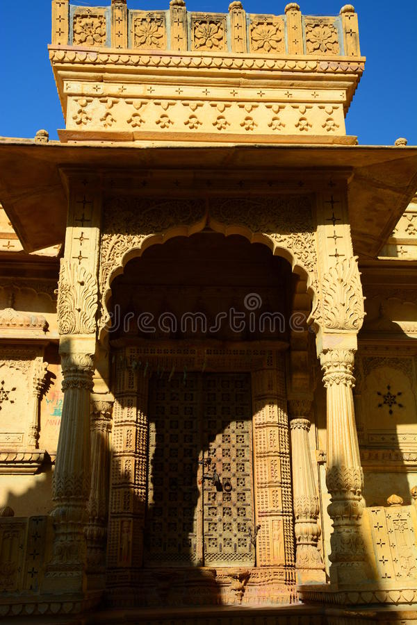 Traditional door. Jaisalmer. Rajasthan. India. Jaisalmer, nicknamed The Golden city, is a city in the Indian state of Rajasthan. The town stands on a ridge of stock photo