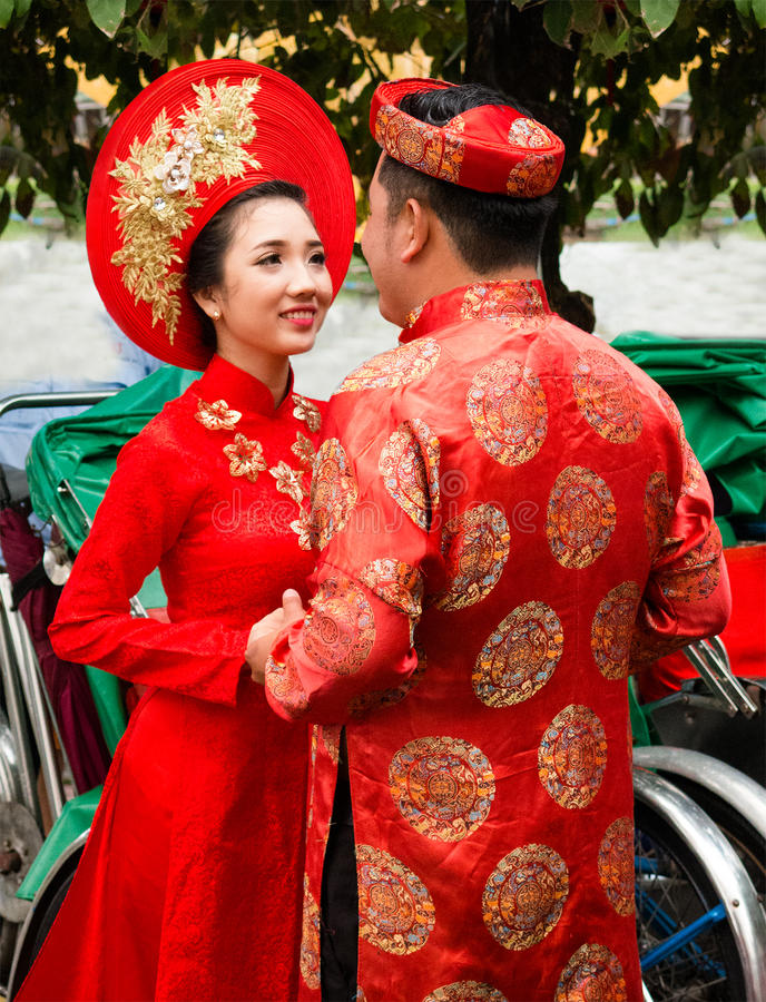 Traditional Dress, Vietnam, Vietnamese People. Vietnamese Man and woman couple wearing traditional formal dress and clothes of their culture. Vietname is a stock images