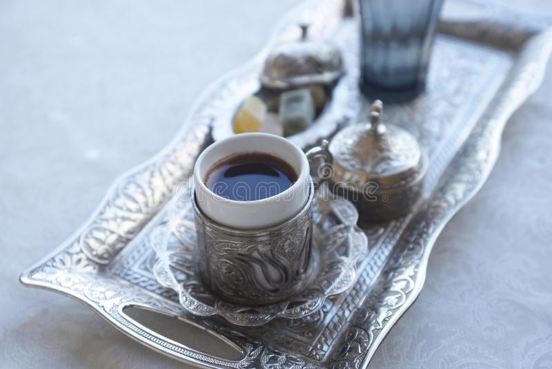 Traditional drink black aromatic coffee i. Ntraditional drink black aromatic coffee in a beautiful silver pot in the morning in Turkey Istanbul royalty free stock images