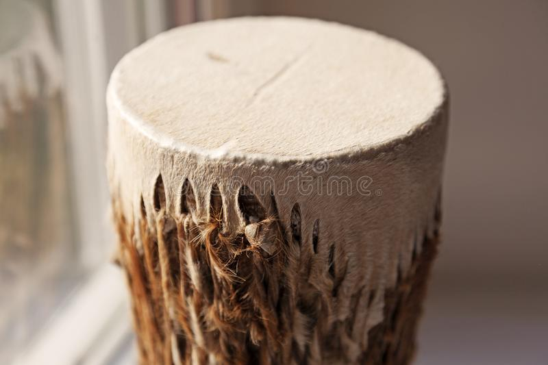 Traditional drum with animal skins and fur stock image