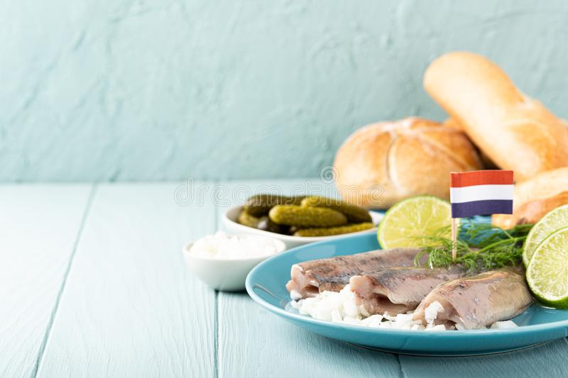 Traditional dutch food herring fish. Traditional dutch food freshly salted herring fish with onion called hollandse nieuwe. European food concept with copy space stock images