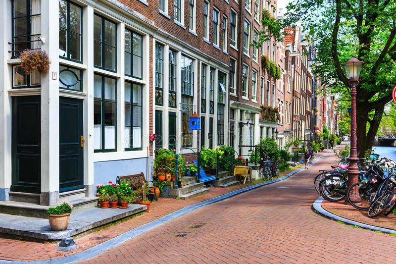 Traditional dutch houses, bicycles parked on city street at summer. Typical holland architecture. Exterior. Amsterdam, Netherlands stock photography