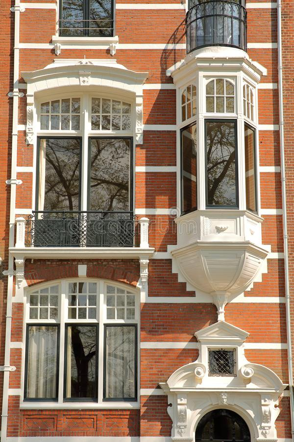 Traditional dutch old facades located on Weesperzijde Street along Amstel river, Amsterdam stock photo
