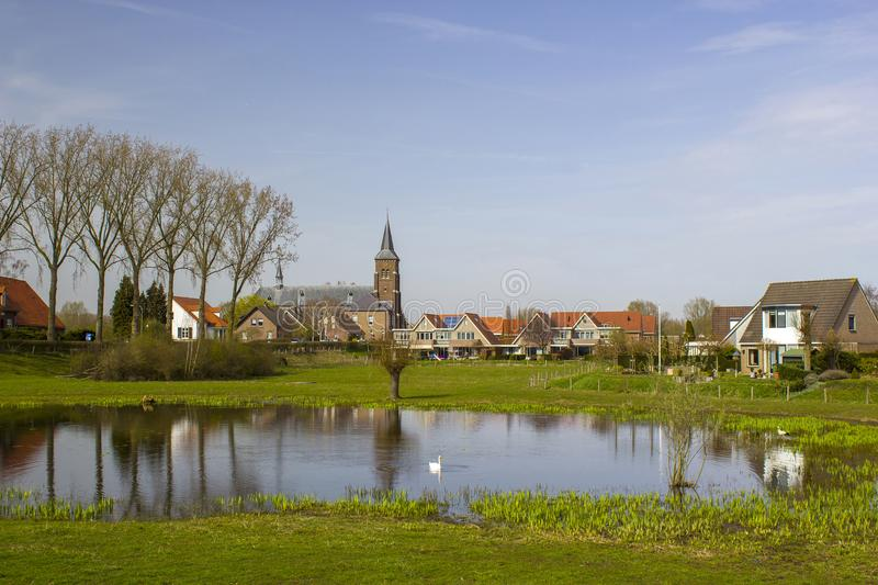 Traditional Dutch village Ooij, Netherlands. Traditional Dutch village Ooij protected by a to prevent flooding by the river Waal, Netherlands royalty free stock image