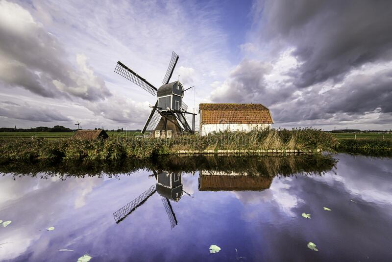 Traditional Dutch windmill with the barn stock images