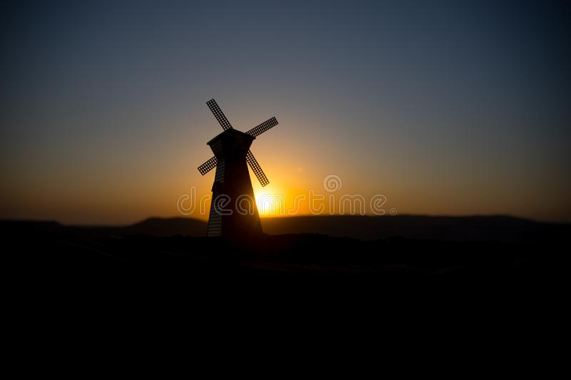 Traditional, Dutch windmill at a hill during a summer sunset. Decoration. Selective focus royalty free stock images