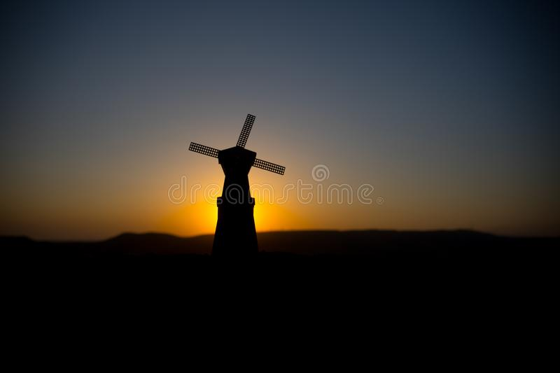 Traditional, Dutch windmill at a hill during a summer sunset. Decoration. Selective focus royalty free stock photography