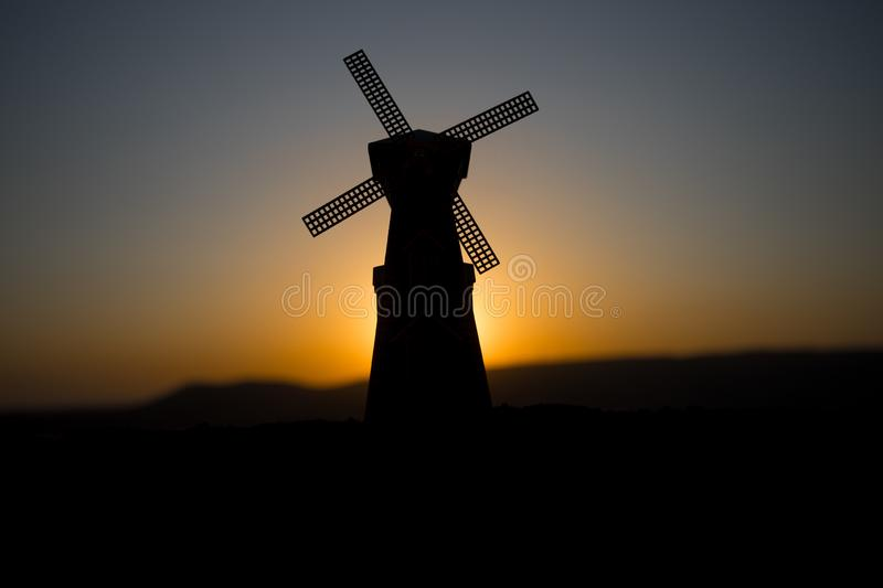 Traditional, Dutch windmill at a hill during a summer sunset. Decoration. Selective focus stock photography