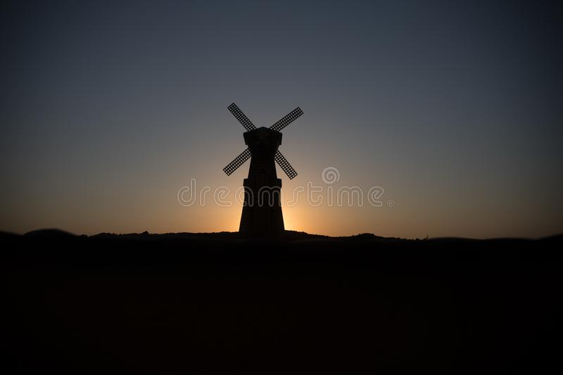 Traditional, Dutch windmill at a hill during a summer sunset. Decoration. Selective focus stock photos