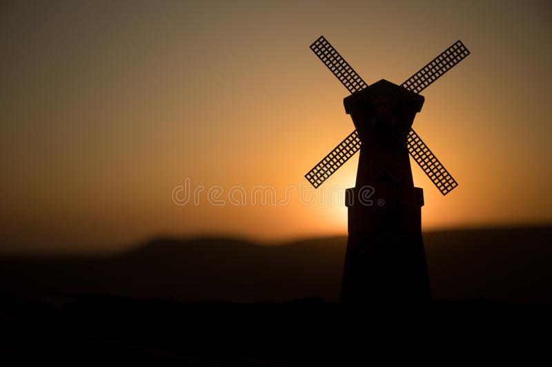 Traditional, Dutch windmill at a hill during a summer sunset. Decoration. Selective focus royalty free stock image