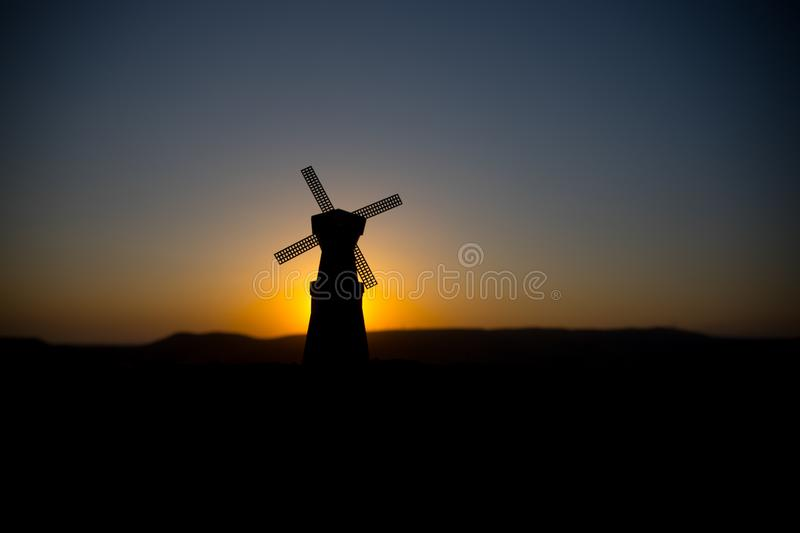 Traditional, Dutch windmill at a hill during a summer sunset. Decoration. Selective focus stock image